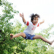 Stock Photo: Jumping kid in the air