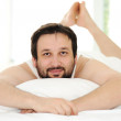 Man in sleeping bed, morning time — Stock Photo