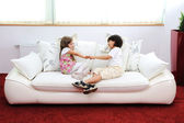 Children at new home with modern furniture — Stok fotoğraf