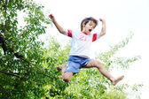 Jumping kid in the air — Stock Photo