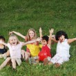 Stock Photo: Happy children raising hands upwards