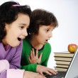 Happiness, beautiful childhood, two beauty girls on laptop — Stock Photo