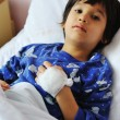 Ill child in hospital - Stock Photo