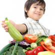 Kid with vegetables — 图库照片