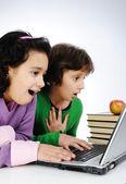 Happiness, beautiful childhood, two beauty girls on laptop — Stock Photo