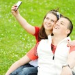 Couple taking photo - Stock Photo