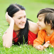 Happy young woman mother play and outdoor with beautiful child — Stock Photo