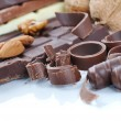 Chocolate, table, pieces, on white background - Foto Stock