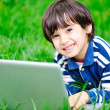 Children activity with laptop in nature — Stock Photo #21414473
