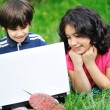 Children activity with laptop in nature — Stock Photo #21414477