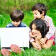 Children activity with laptop in nature — Stock Photo #21414509
