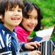 Children activity with laptop in nature — Stock Photo