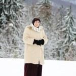 Muslim woman on snow — Stock Photo #21417993