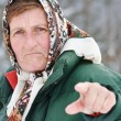 Elderly woman threating - Stock Photo