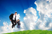 Father with son jump — Stock Photo