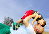 Happy father or grandfather and son on beautiful background — Stock Photo