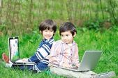 Happy children in nature outdoor — Stockfoto