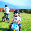 two kids are playing with toy trucks in the park  — Stok fotoğraf