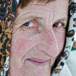 Elderly woman with scarf — Stock Photo