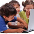 Happy kids with laptop computer isolated — Stock Photo