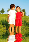 Two children on river — Stock Photo