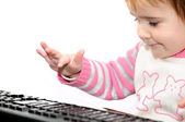 Baby on keyboard — Stock Photo