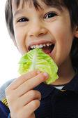 Kid eating salad — Stock Photo