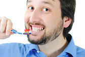 Young man brushing teeth close up shoot — Stock Photo