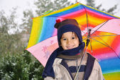 The boy with an umbrella standing under a rain — Stock Photo