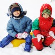 Happy children in snow — Stock Photo