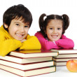 Tow kids learning at the desk with lot of books, — Stock Photo #21430903