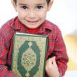 Muslim kid with holy book Koran — Stock Photo