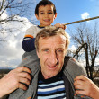 Joying kid and grandfather - Stock Photo