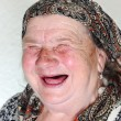 Elderly person, portrait in natural pose laughing — Stockfoto