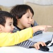 Childhood, laptop, learning and playing — Stock Photo #21435881