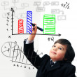 Child drawing a diagram on digital screen — Stock Photo