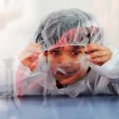 Smart cute little male child experimenting with test tubes in real modern hospital lab — Stock Photo #21438423