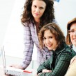 While meeting, group of young women working together on the table — Stock Photo #21439299