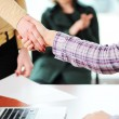 Closing a successful deal with a handshake. Signed contract and applause in the background. — Stock Photo #21439959