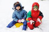 Happy children in snow — Stock Photo