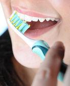 Young girl brushing her teeth — Stock Photo