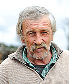 Elderly person, portrait in natural pose — Stock Photo