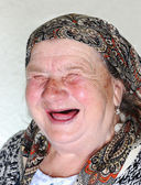 Elderly person, portrait in natural pose laughing — Stock Photo