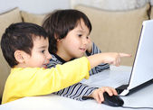 Childhood, laptop, learning and playing — Stock Photo
