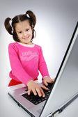 Girl on laptop — Stock Photo