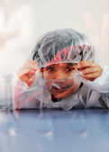 Smart cute little male child experimenting with test tubes in real modern hospital lab — Stock Photo