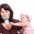 Mom is feeding her baby and vice versa — Stock Photo