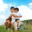 Two kids on back of their gradmother — Stock Photo