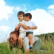 Two kids on back of their gradmother — Stock Photo #21443215