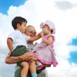 Grandmother and kids in her armful — Stock Photo